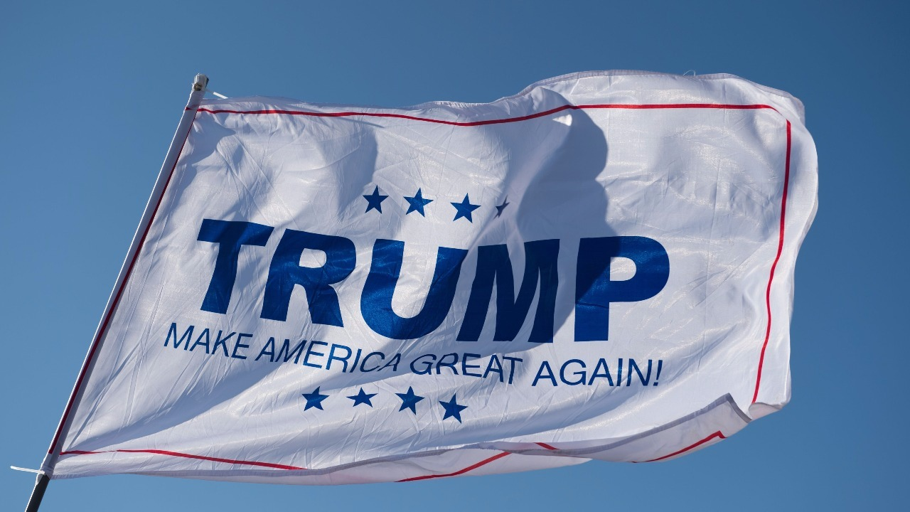 Donald Trump campaign flag waves outside a trump rally at Millington ...