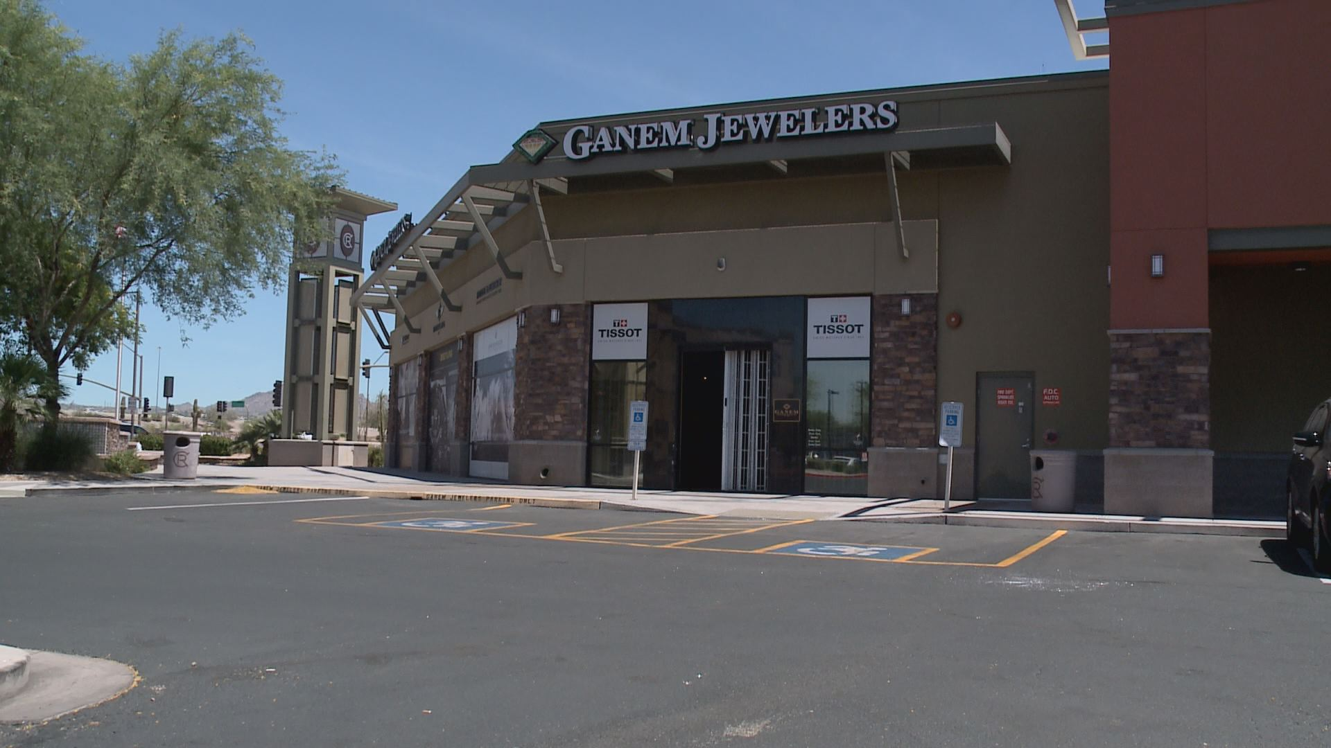 car drives through front of jewelry store